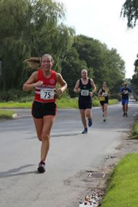 Sutton 10k runners in action on Carr Lane